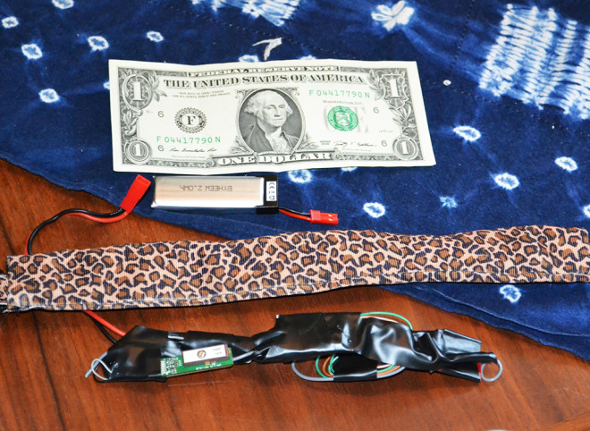 The WarKitteh collar with its components and wiring removed, with a dollar bill for scale. Gene Bransfield